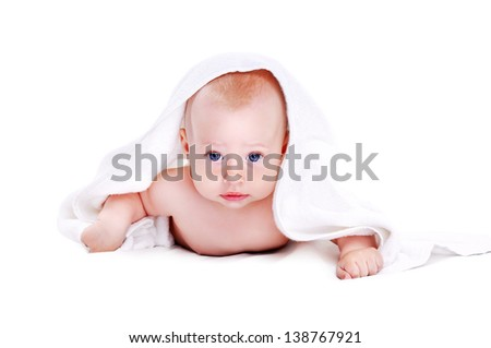 Baby boy lying under the white towel isolated on white background