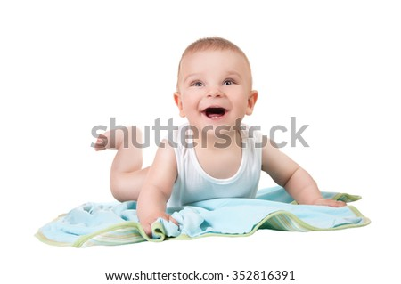 Baby boy, 6-9 months old, laughing and trying to get up - stock photo