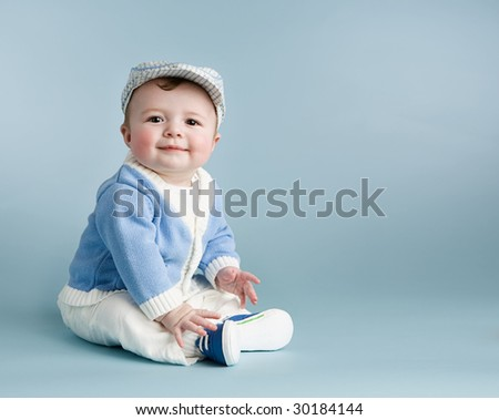 baby boy on blue with hat - stock photo