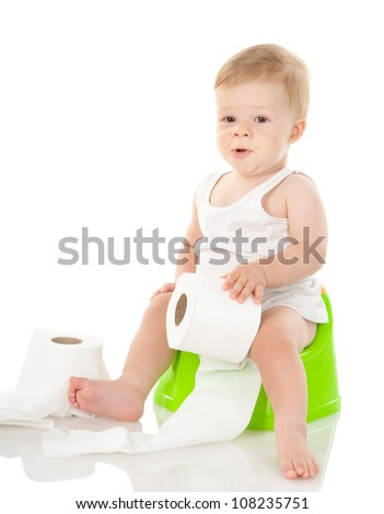 baby boy on chamber pot with toilet paper. isolated on white background - stock photo