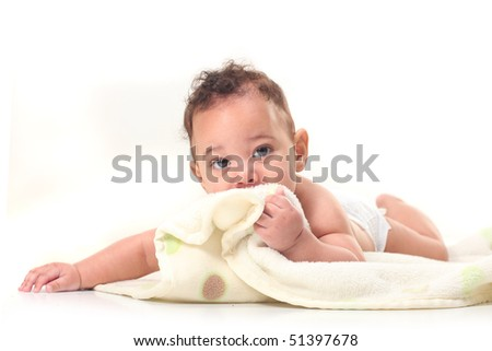 Baby Boy on Stomach Playing With Blankets on White Background - stock photo