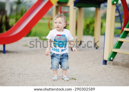 baby boy on the background of the playground