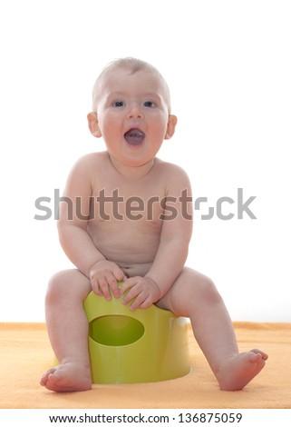 baby boy on the potty - stock photo
