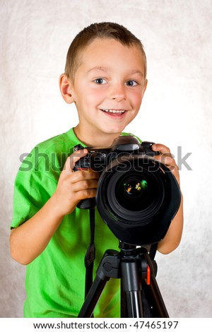 Baby boy photographer holds camera
