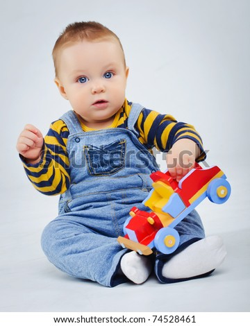 baby boy plaing his toy car - stock photo