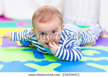 Baby boy playing at home - stock photo