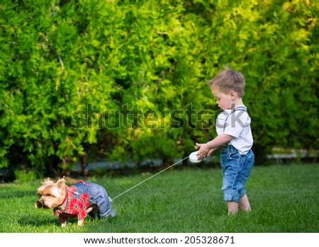 baby boy  playing on the lawn