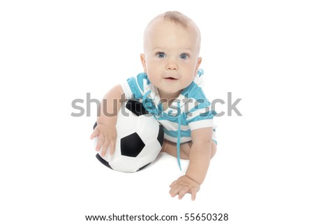 Baby boy playing with a soccer ball - stock photo