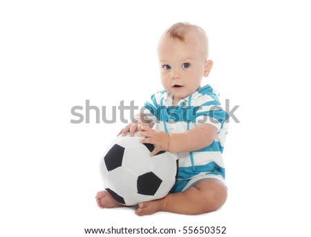 Baby boy playing with a soccer ball