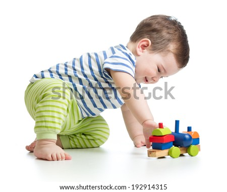 baby boy playing with block toys - stock photo