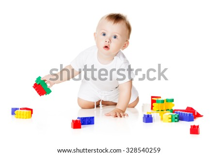 baby boy playing with bright toys on white background