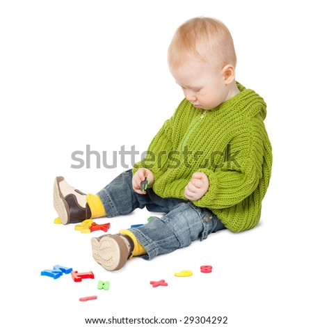 baby boy playing with letters isolated on white