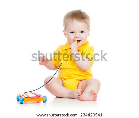 baby boy playing  with musical toy isolated - stock photo