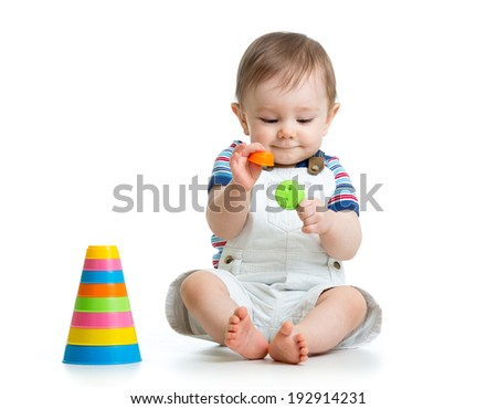 baby boy playing with toy isolated on white background