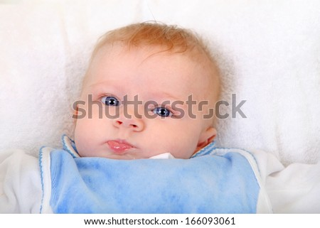 Baby Boy Portrait on the White Blanket Closeup