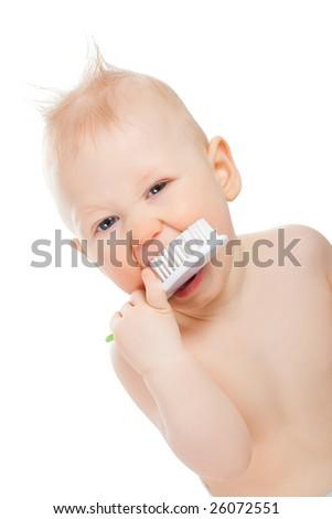 baby boy portrait with brush on white - stock photo