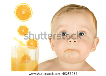 baby boy portrait with orange juice isolated on a white background - stock photo