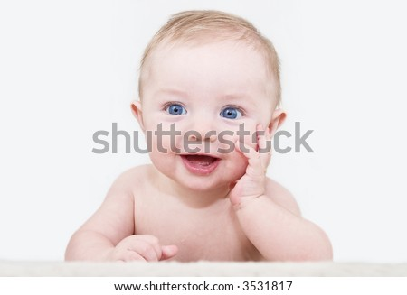 Baby boy posing for his first portrait - stock photo