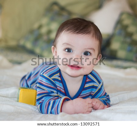 Baby Boy Posing in Striped Outfit - stock photo
