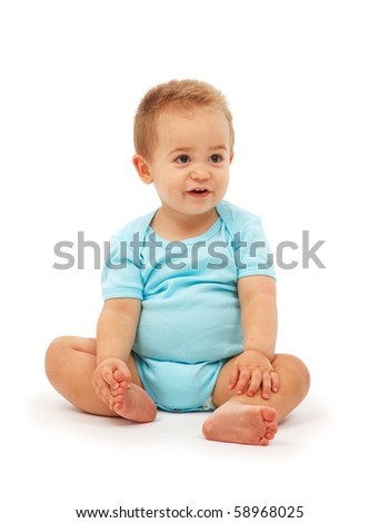 Baby boy's simple sitting and watching - stock photo