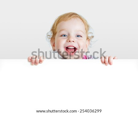 Baby boy showing blank placard with copy space. - stock photo