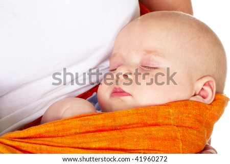 baby boy sleeping in mother arms; closeup - stock photo