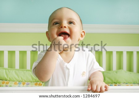 Baby Boy Smiling in crib - stock photo
