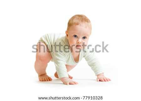 Baby boy toddler isolated trying to stand up - stock photo