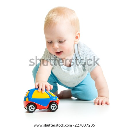 baby boy toddler playing with toy car isolated - stock photo
