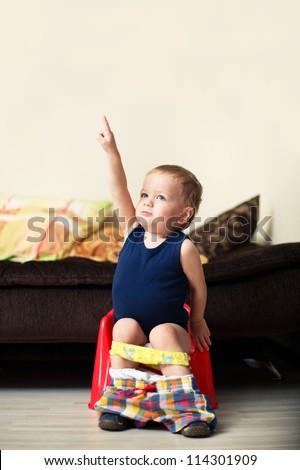 baby boy toddler sitting on the potty - stock photo