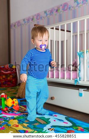 Baby boy walking on the floor - stock photo