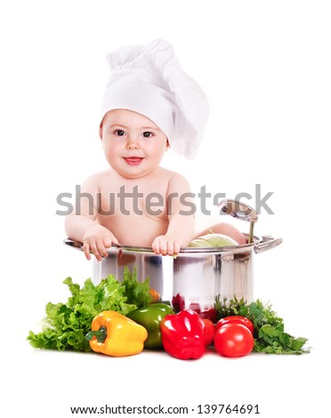 Baby boy wearing chef hat sitting in big saucepan isolated on white