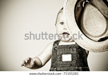 Baby boy with a hat happy with the situation. - stock photo