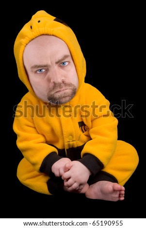 Baby boy with a man's face in a bumble bee costume isolated over a black background - stock photo