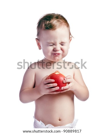 baby boy with apple - stock photo