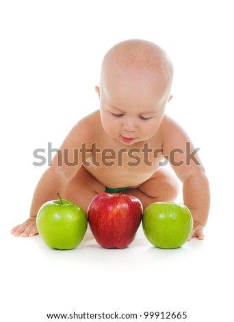 baby boy with apples on white background - stock photo