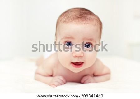 Baby boy with blue eyes - stock photo