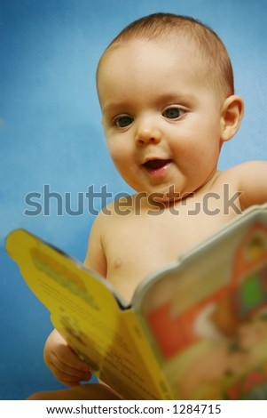 Baby Boy with Book [approx. 7 mos.] - stock photo