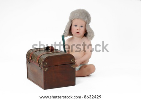 Baby boy with coffer - stock photo