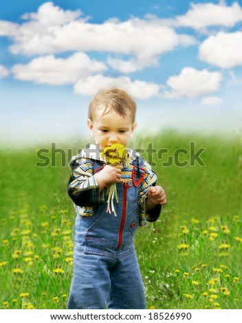 baby boy with dandelions on sky background - stock photo
