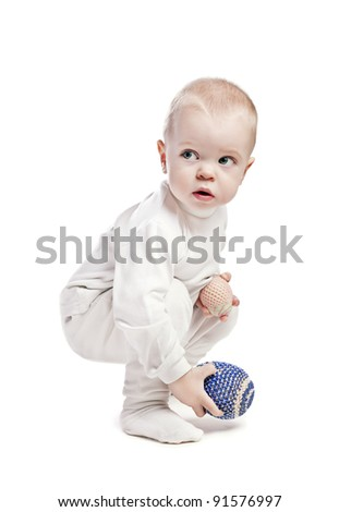 baby boy with easter eggs - stock photo