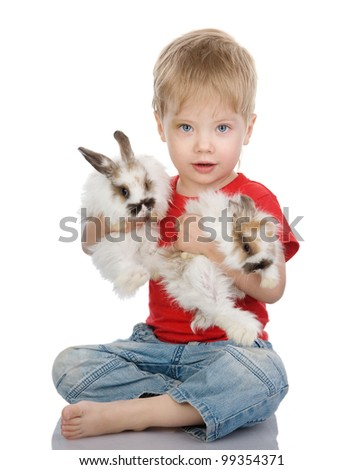 baby boy with easter rabbits. isolated on white background - stock photo