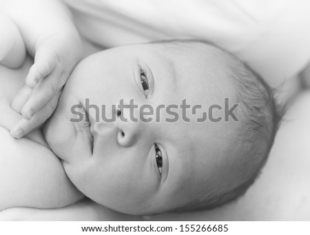 Baby boy with eyes opened - stock photo