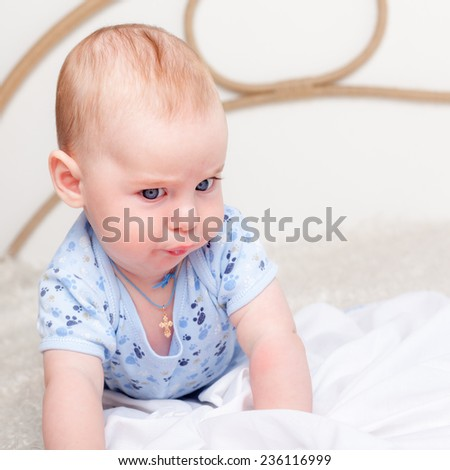 Baby boy with funny face - stock photo