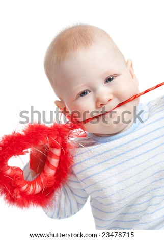 baby boy with furry heart in mouth, white background