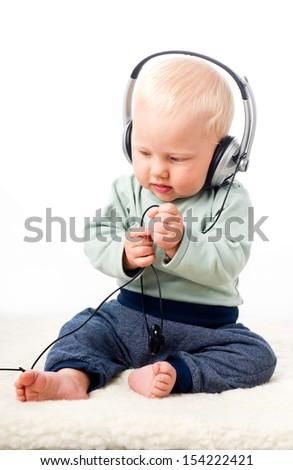 Baby boy with headphones  - stock photo