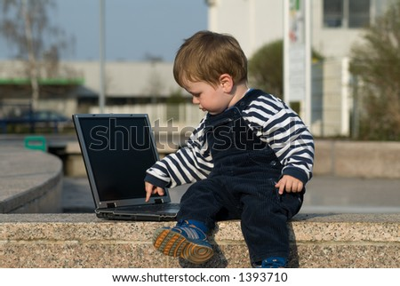 baby boy with laptop outside