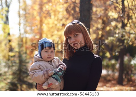 Baby boy with mother play in park - stock photo