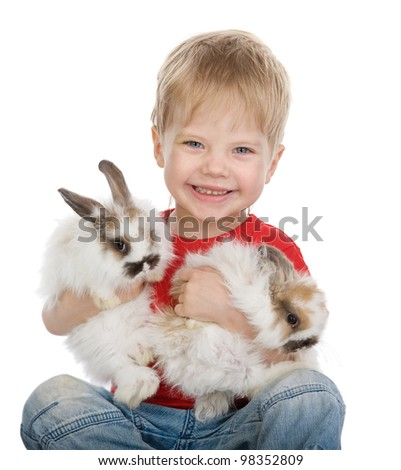 baby boy with rabbits. isolated on white background - stock photo