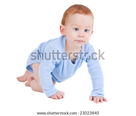 Baby boy with red hair crawling on white background